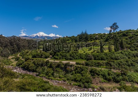 A view of the Cayambe volcano in the Andes Mountains near Quito, Ecuador. - stock photo