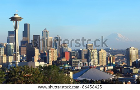 A view of the city of Seattle skyline and Mt. Rainier at sunset. - stock photo