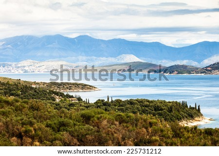A view of the coastline of north-east Corfu, Greece, with the Albanian mountains across the strait. - stock photo