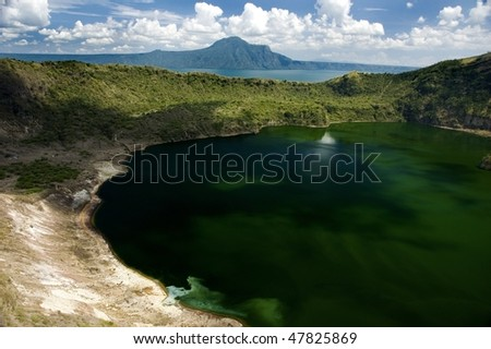 A view of the famous Taal volcano and Taal Lake in Tagaytay City, Philippines. - stock photo