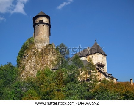 A view of the highest and oldest part of famous Orava Castle situated on a high rock. This Romanesque citadel was build in 13th century as a guardian fortification on the road to Poland. - stock photo