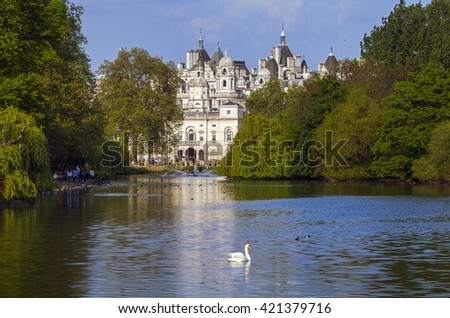 A view of the Horse Guards building over the lake in St. James's Park, London. - stock photo