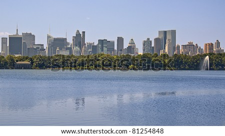 A view of the Jacqueline Kennedy Onassis reservoir a beautiful Manhattan skyline in the background - stock photo