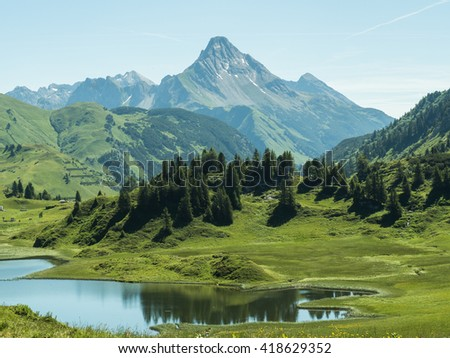 A view of the Kalbelesee lake surrounded by the Alpine mountains near village Schroecken in Bregenzerwald, region Vorarlberg, Austria