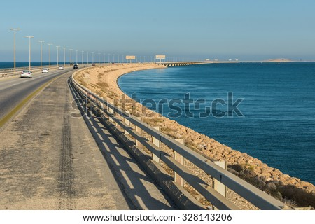 A view of the King Fahd Causeway between Saudi Arabia and Bahrain showing the view from Saudi Arabia. - stock photo