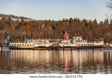 A view of the maid of the loch paddle steamer from across loch lomond near the scottish town of balloch. - stock photo