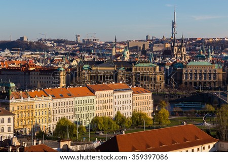 A view of the Prague Skyline from the Lesser Quarter to the Old Town during the day in the autmn. Lots  of buildings can be seen. - stock photo
