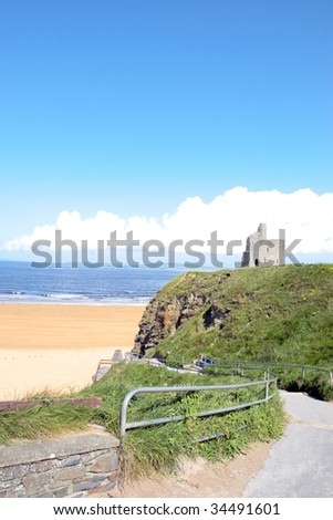 a view of the steps and castle to the beach in ballybunion co kerry ireland - stock photo