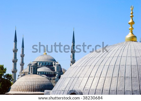 A view of the Sultan Ahmet mosque from behind other cupolas - stock photo