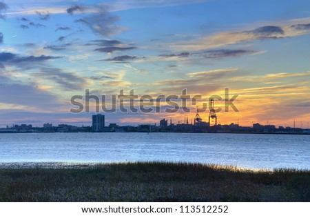 A View of the Sunset Behind the Port in the Harbor of Charleston, SC - stock photo