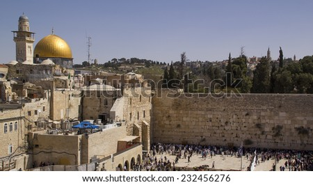 A view of the Temple Mount in Jerusalem, including the Western Wall and the golden Dome of the Rock. - stock photo