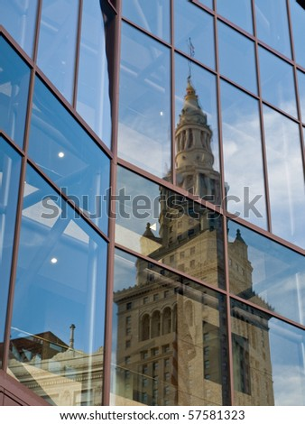A view of the Terminal Tower reflected in the glass of an adjacent building - stock photo