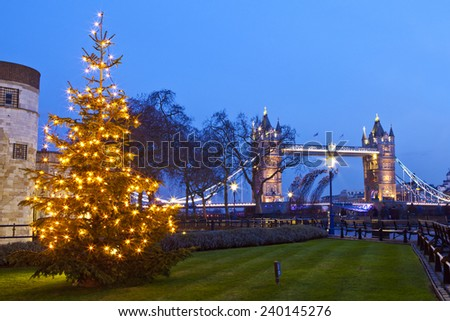 A view of Tower Bridge and a Christmas Tree in London. - stock photo