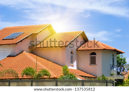 A view of typical vintage house with tile roof - stock photo