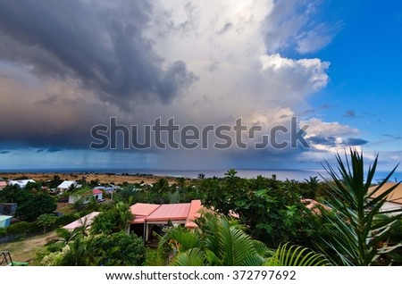 A view on a shower from the westcoast of Reunion Island - stock photo