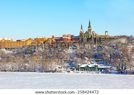 A view on Georgetown University after snow storm. Winter at Georgetown suburb of Washington DC. - stock photo