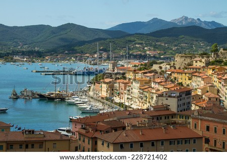 A view on the harbour of Portoferraio in the island of Elba, off the coast of Tuscany in Italy, on a beautiful summer day. - stock photo