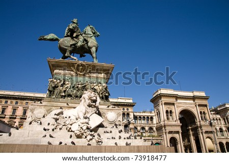 A view on the main square of Milan, the Piazza del Duomo, with the statue of Vittorio Emanuele II and the Galleria Vittorio Emanuele II, Italy - stock photo
