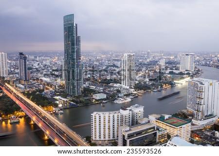 a view over the big asian city of Bangkok, Thailand at nighttime - stock photo
