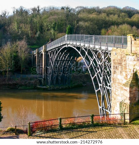 A view over the River Severn in Shropshire, England, with the Iron Bridge which gave the nearby town of Ironbridge its name.  The bridge was the first arch bridge in the world to be made of cast iron. - stock photo