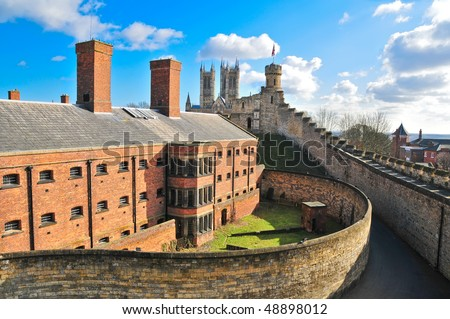 A view over the walls of Lincoln cathedral to the cathedral and city beyond. - stock photo