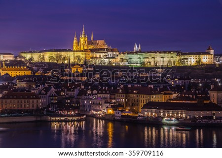 A view Prague Skyline at dusk from Old Town to the Lesser Quarter. Colorful Buildings and Prague Castle can be seen. - stock photo