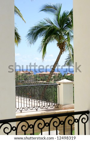A view through a balcony window in Mexico. - stock photo