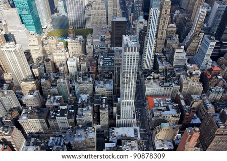 A view tumbling down into midtown Manhattan with Bryant Park and 5th Avenue.