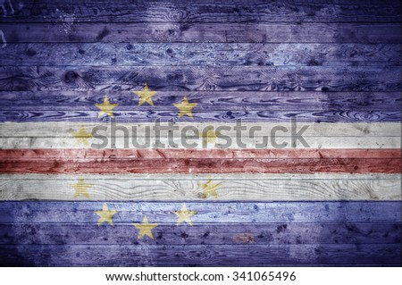 A vignetted background image of the flag of Cape Verde painted onto wooden boards of a wall or floor. - stock photo