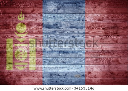 A vignetted background image of the flag of Mongolia painted onto wooden boards of a wall or floor. - stock photo