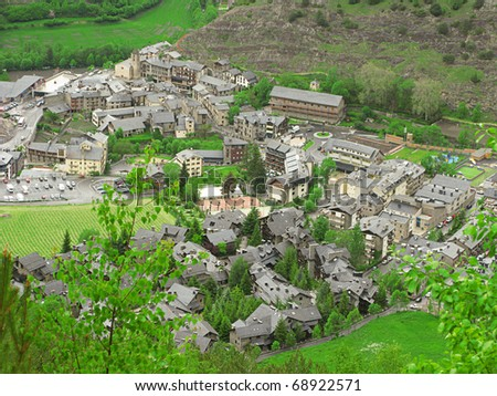 A village  into a pyrenees valley, between mountains and surrounded by green