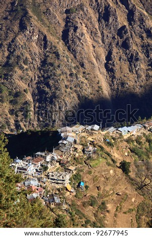 A village is located in a spur on top of a valley, looking from above - stock photo