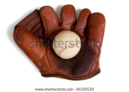 A vintage, antique leather baseball glove with a baseball on a white background
