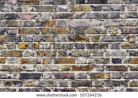 A vintage brick wall background - stock photo