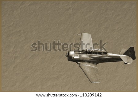 a vintage fighter plane on a sepia background - stock photo