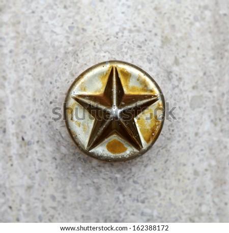 A vintage golden star button.  - stock photo