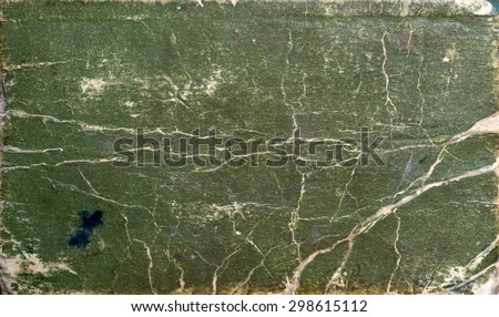A vintage green background with a grunge pattern. - stock photo