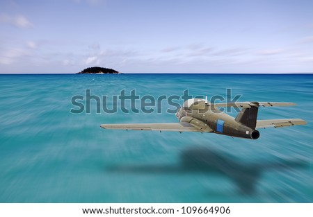 A vintage jet plane flying at low altitude towards a small island in the middle of a vast blue ocean.