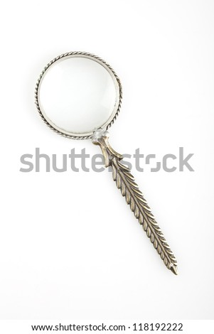 A vintage magnifying glass on white background. - stock photo