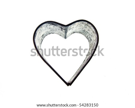 A vintage metal heart shaped sugar dough cookie cutter on an isolated white background - stock photo