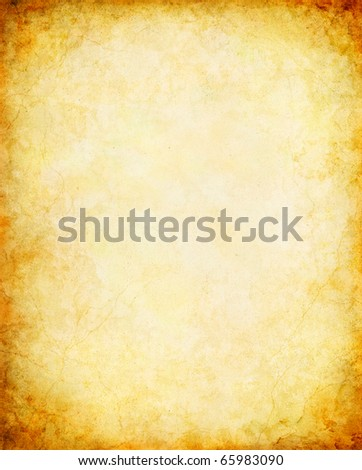 A vintage paper background with a glowing center and grunge vignette. - stock photo