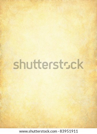 A vintage paper background with a glowing center and subtle grunge patterns and textures. - stock photo