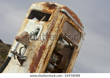 A vintage rusted gas pump abandoned in the desert - stock photo