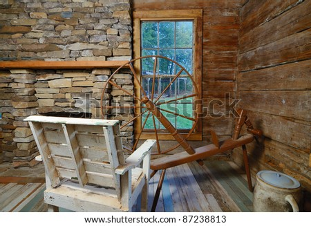 a vintage spinning wheel loom in a period style house