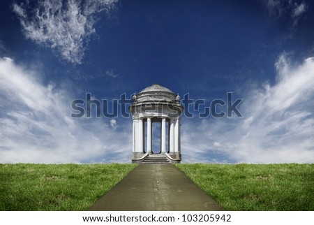 A vintage stone mason pavilion in a green field against a dramatic blue cloudy sky. - stock photo