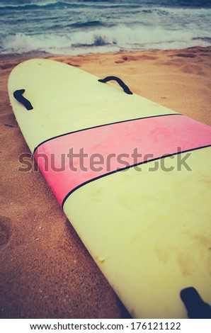 A Vintage Surf Board On A Deserted Wild Beach In Hawaii - stock photo