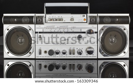 a vintage tape player and radio against black