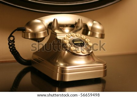 A vintage telephone in black and white