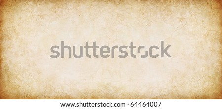 A vintage, textured paper background in a panorama format. - stock photo