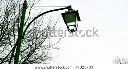 A vintage traditional street lamp light in an alley